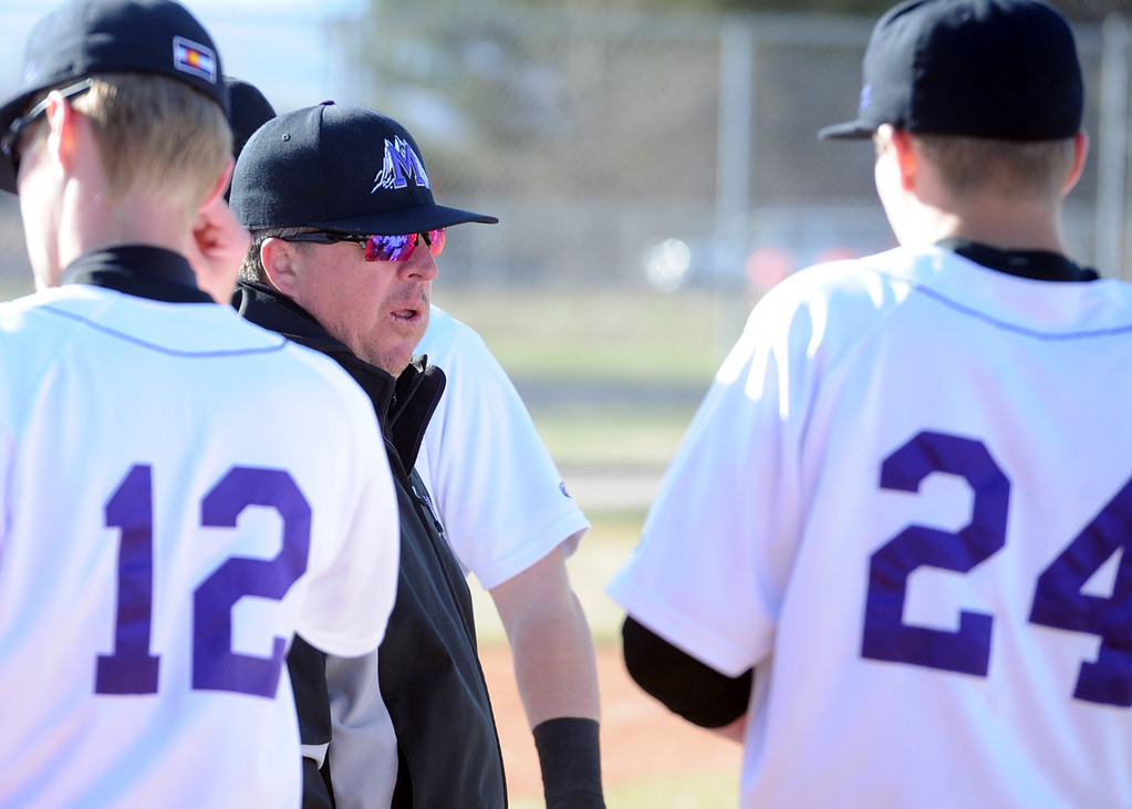 . Mountain View baseball coach Brian Smela talks with his team between innings on Tuesday, April 3, 2018 at Brock Field in Loveland. (Sean Star/Loveland Reporter-Herald)