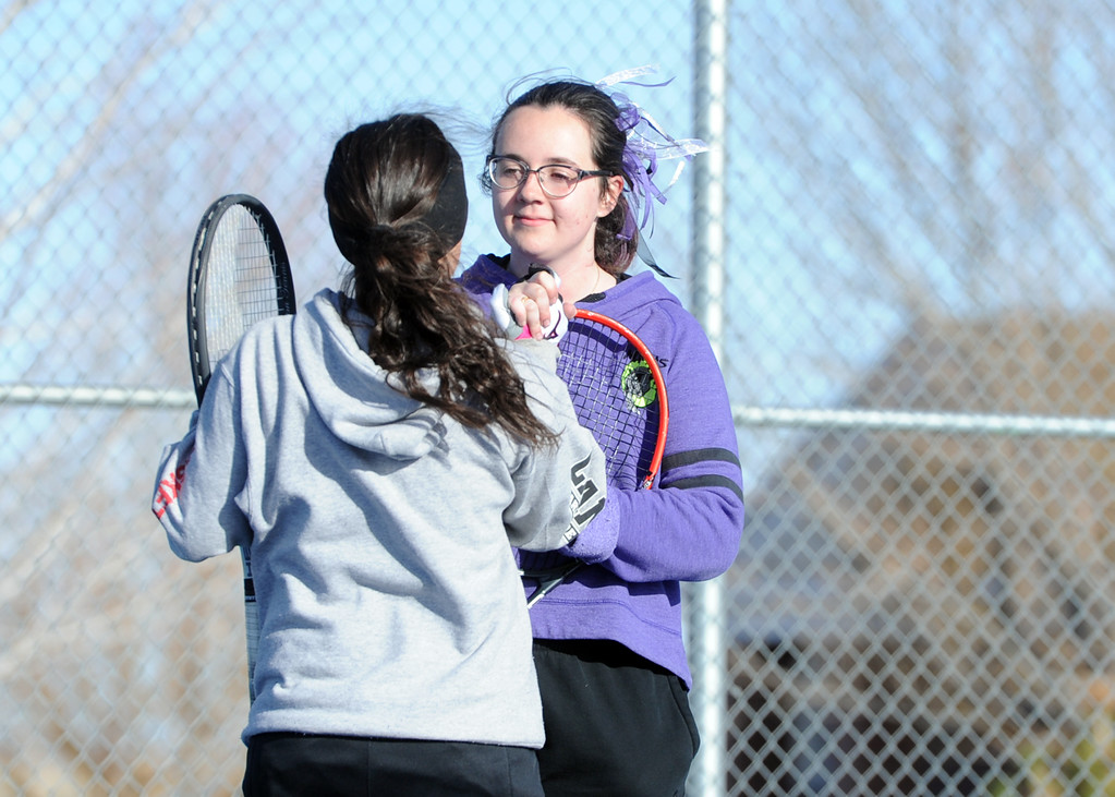 . Mountain View\'s Dusty Berglund, right, high-fives teammate Kali Kelley during a match Tuesday, April 3, 2018 at Mountain View High School. (Sean Star/Loveland Reporter-Herald)