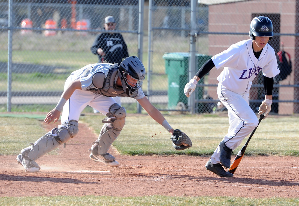 . Mountain View\'s Tanner Cartmell takes off for first after striking out on Tuesday, April 3, 2018 at Brock Field in Loveland. (Sean Star/Loveland Reporter-Herald)