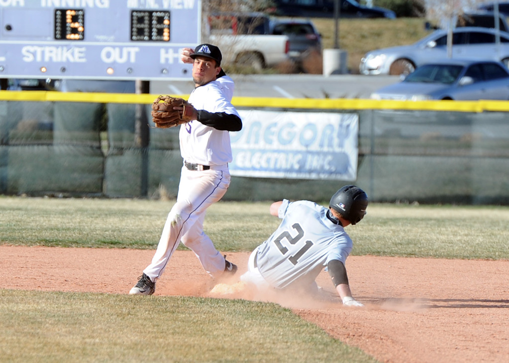 . Mountain View second baseman TJ Mendoza throws to first after a force out at second on Tuesday, April 3, 2018 at Brock Field in Loveland. (Sean Star/Loveland Reporter-Herald)