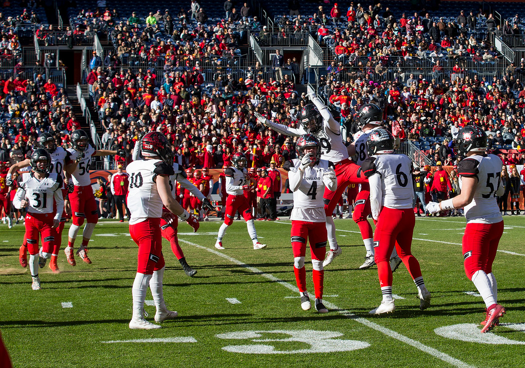 . Loveland celebrates recovering a fumbled kickoff against Skyline Saturday afternoon during the CHSAA 4A State Championship game at Broncos Stadium in Denver. The Loveland Indians won, beating the Skyline Falcons 62-14. (Michael Brian/For the Reporter-Herald)