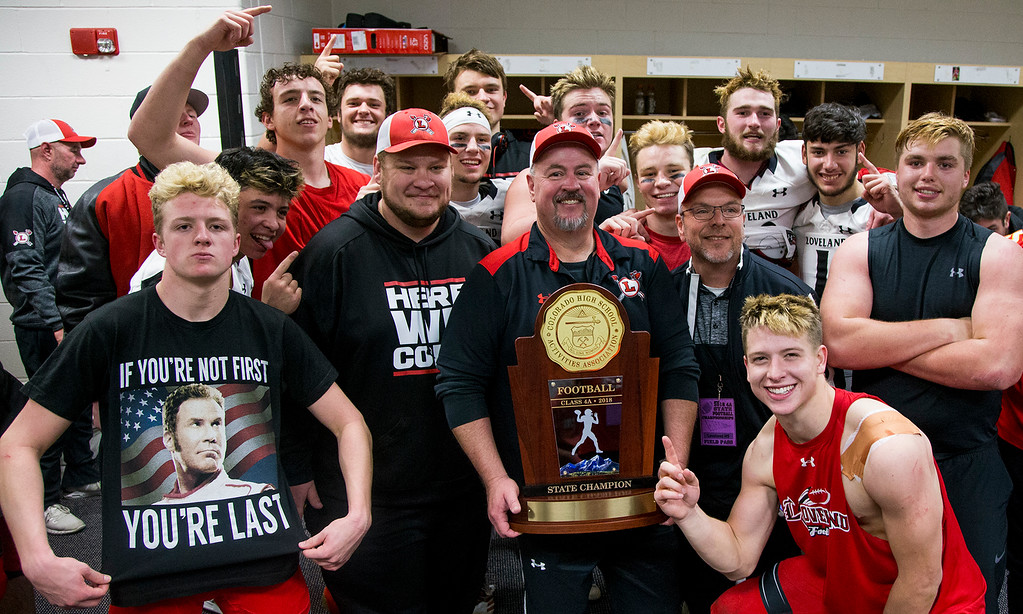 . Defensive coaches and players pose for a photo as the Loveland Indians celebrate their 62-14 CHSAA 4A State Championship victory over Skyline Saturday afternoon Dec., 1, 2018 at Broncos Stadium in Denver. (Michael Brian/For the Reporter-Herald)