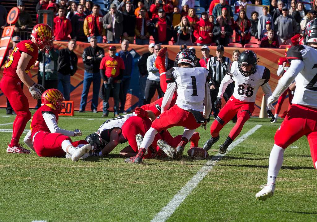 . Loveland players dive for a fumble on the opening kickoff against Skyline Saturday afternoon during the CHSAA 4A State Championship game at Broncos Stadium in Denver. (Michael Brian/For the Reporter-Herald)