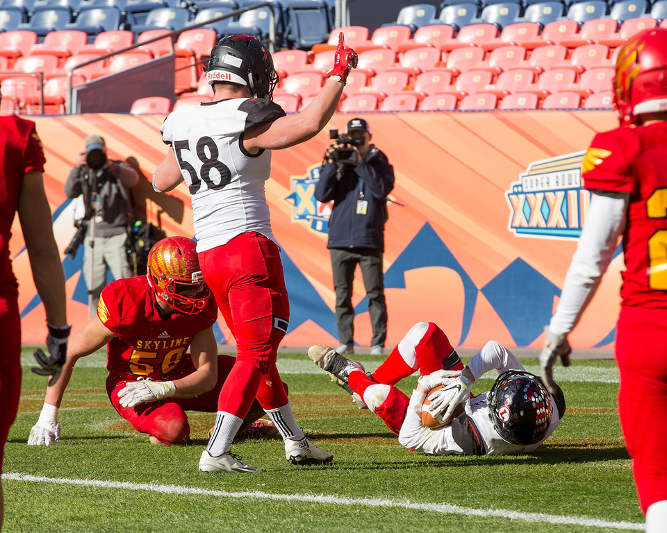 . Loveland\'s Cody Rakowsky (4) scores a touchdown against Skyline Saturday afternoon Dec., 1, 2018 during the CHSAA 4A State Championship game at Broncos Stadium in Denver. The Loveland Indians won, beating the Skyline Falcons 62-14. (Michael Brian/For the Reporter-Herald)