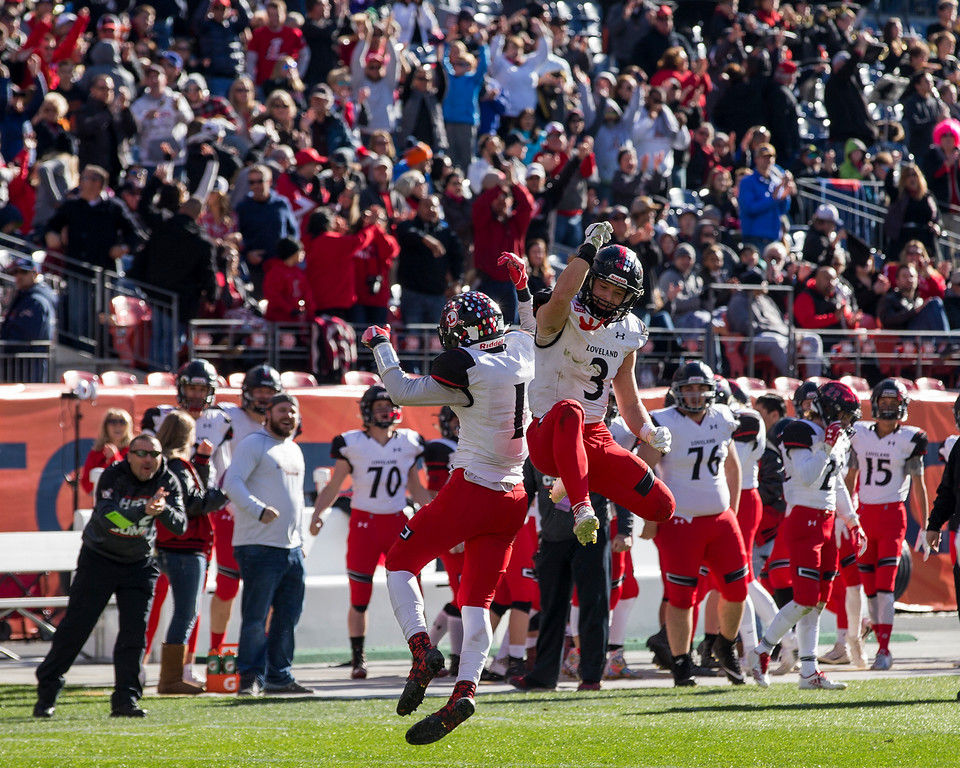 . Loveland\'s Isaiah Meyers (1) and Zach Weinmaster (3) celebrate a touchdown against Skyline Saturday afternoon Dec., 1, 2018 during the CHSAA 4A State Championship game at Broncos Stadium in Denver. The Loveland Indians won, beating the Skyline Falcons 62-14. (Michael Brian/For the Reporter-Herald)