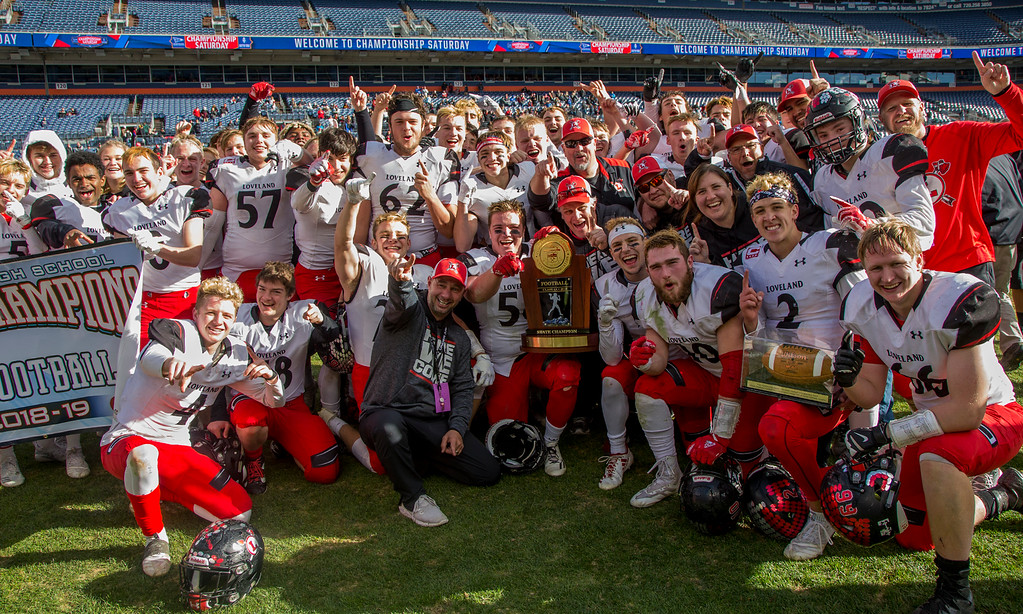 . The Loveland Indians celebrate their 62-14 CHSAA 4A State Championship victory over Skyline Saturday afternoon Dec., 1, 2018 at Broncos Stadium in Denver. (Michael Brian/For the Reporter-Herald)