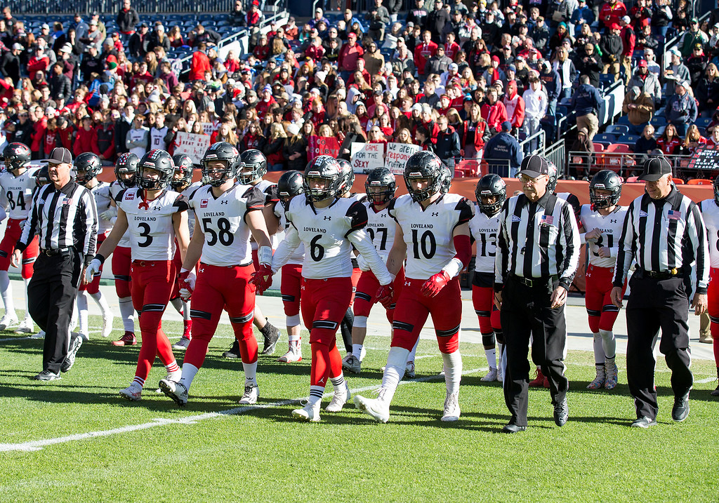 . Loveland captains head for the coin toss against Skyline Saturday afternoon Dec., 1, 2018 during the CHSAA 4A State Championship game at Broncos Stadium in Denver. The Loveland Indians won, beating the Skyline Falcons 62-14. (Michael Brian/For the Reporter-Herald)