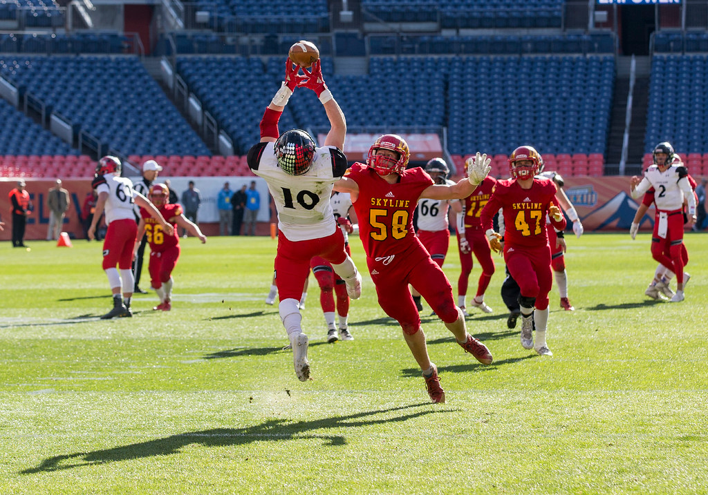 . Loveland\'s Sean Boylan (10) leaps for a deep pass against Skyline Saturday afternoon Dec., 1, 2018 during the CHSAA 4A State Championship game at Broncos Stadium in Denver. Boylan bobbled but caught the ball and Loveland went on to win, beating the Skyline Falcons 62-14. (Michael Brian/For the Reporter-Herald)