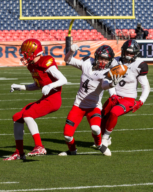 . Loveland cornerback Cody Rakowsky (4) picks off a pass against Skyline Saturday afternoon during the CHSAA 4A State Championship game at Broncos Stadium in Denver. (Michael Brian/For the Reporter-Herald)