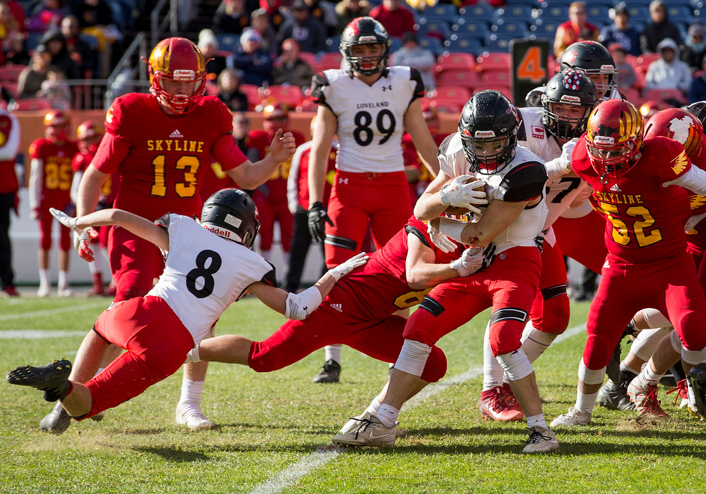 . Loveland\'s Cody Donovan (27) runs the ball for the final play against Skyline as the Loveland Indians captured the CHSAA 4A State Championship 62-14 Saturday afternoon Dec., 1, 2018 at Broncos Stadium in Denver. (Michael Brian/For the Reporter-Herald)