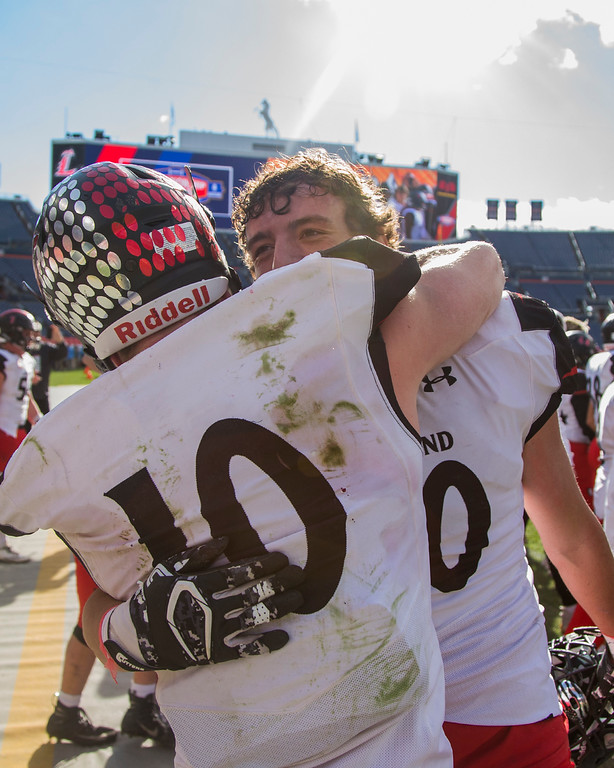 . Loveland\'s Sean Boylan (10) and Javon Hackett (20) celebrate the Indians CHSAA 4A State Championship victory over Skyline Saturday afternoon Dec., 1, 2018 at Broncos Stadium in Denver. The Loveland Indians won 62-14. (Michael Brian/For the Reporter-Herald)