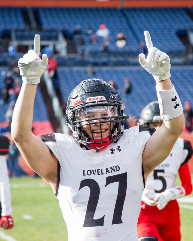 . Loveland\'s Cody Donovan (27) celebrates the Indians CHSAA 4A State Championship victory over Skyline Saturday afternoon Dec., 1, 2018 at Broncos Stadium in Denver. The Loveland Indians won 62-14. (Michael Brian/For the Reporter-Herald)