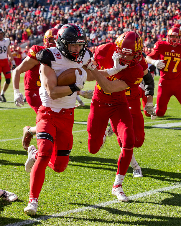 . Loveland\'s Zach Weinmaster (3) fights off a tackle from Skyline\'s Creighton Trembly (17) Saturday afternoon Dec., 1, 2018 during the CHSAA 4A State Championship game at Broncos Stadium in Denver. The Loveland Indians won, beating the Skyline Falcons 62-14. (Michael Brian/For the Reporter-Herald)