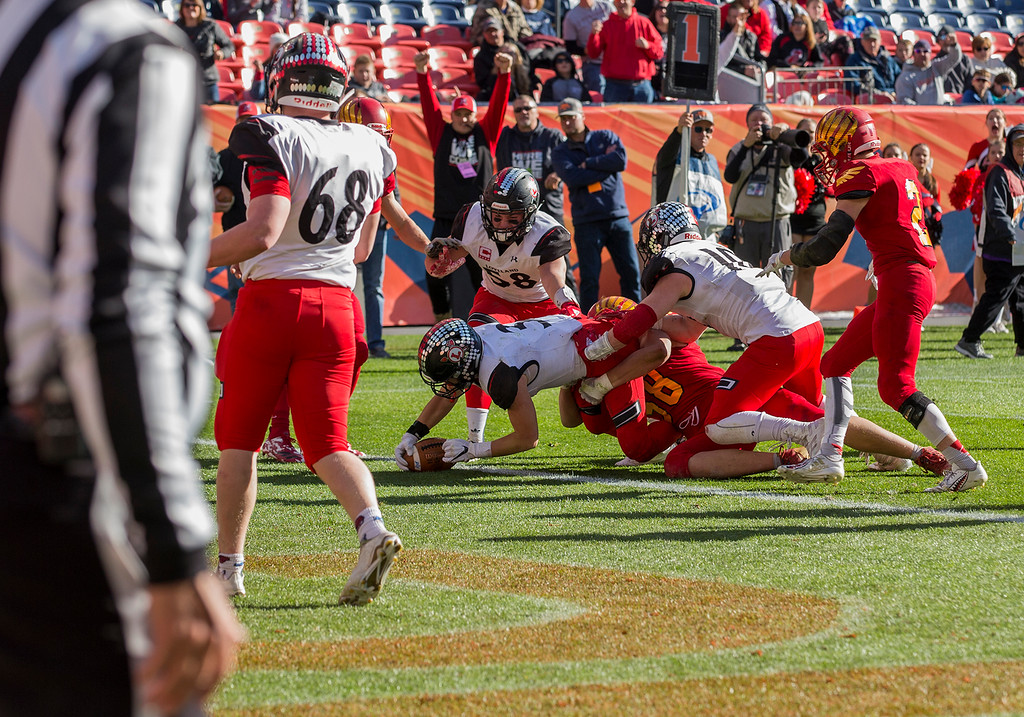 . Loveland\'s Zach Weinmaster (3) dives for a touchdown against Skyline Saturday afternoon Dec., 1, 2018 during the CHSAA 4A State Championship game at Broncos Stadium in Denver. The Loveland Indians won, beating the Skyline Falcons 62-14. (Michael Brian/For the Reporter-Herald)