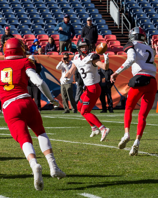 . Loveland\'s Zach Weinmaster (3) takes the shovel pass from Riley Kinny (2) against Skyline Saturday afternoon Dec., 1, 2018 during the CHSAA 4A State Championship game at Broncos Stadium in Denver. The Loveland Indians won, beating the Skyline Falcons 62-14. (Michael Brian/For the Reporter-Herald)