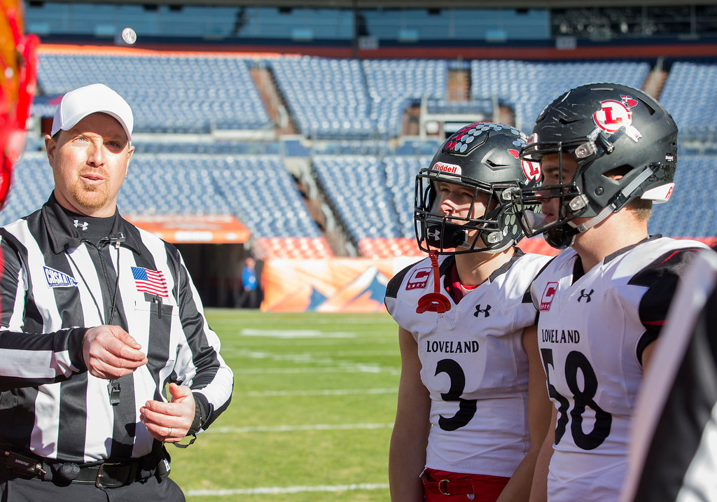 . Lovelandach Weinmaster (3) and Michael Deschene (58) watch the coin toss against Skyline Saturday afternoon Dec., 1, 2018 during the CHSAA 4A State Championship game at Broncos Stadium in Denver. The Loveland Indians won, beating the Skyline Falcons 62-14. (Michael Brian/For the Reporter-Herald)
