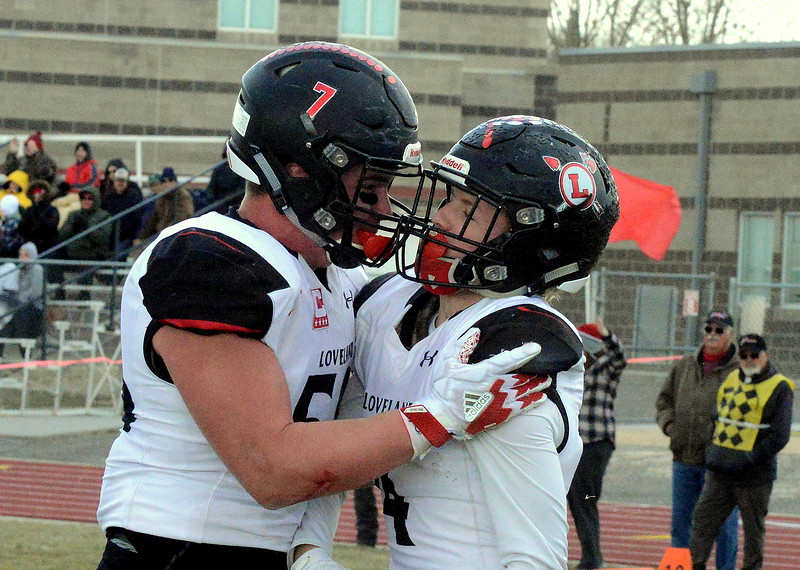Loveland offensive lineman Micahel Deschene congratulates Cody Rakowsky after his touchdown run in the second quarter during Saturday's 4A state semfinal game at Montrose. Loveland won 42-0 to advance to the state championship. (Mike Brohard/Loveland Reporter-Herald)