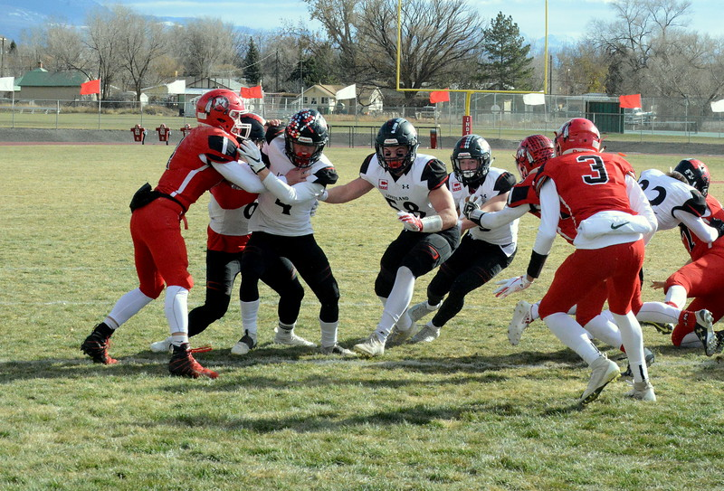 Loveland's Zach Weinmaster follows his blocking toward the goal line during Saturday's 4A state semfinal game at Montrose. Loveland won 42-0 to advance to the state championship. (Mike Brohard/Loveland Reporter-Herald)