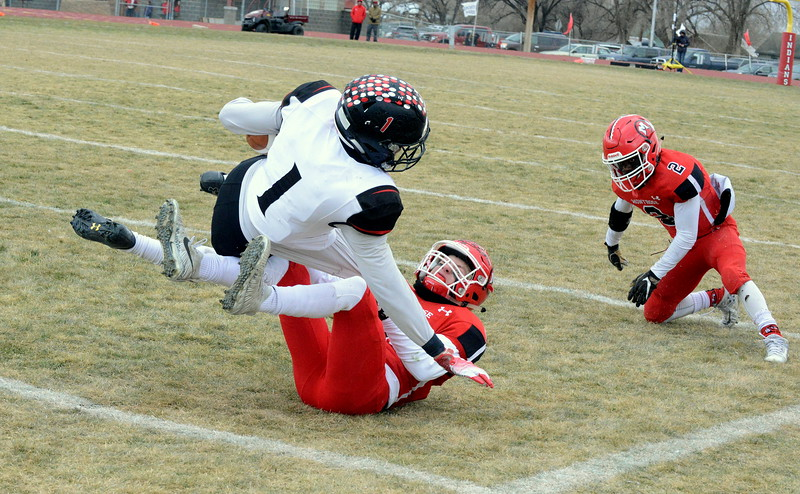 Loveland's Isaiah Meyers is taken down on the sidelines by Montrose's Chris Eckerman duing Saturday's 4A state semifinal game in Montrose. Loveland won 42-0 to advance to the state championship. (Mike Brohard/Loveland Reporter-Herald)