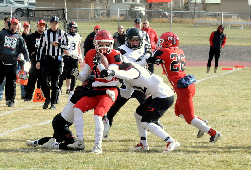 Loveland's defense swarms Montrose return man Aaron Deitrich during Saturday's 4A state semfinal game at Montrose. Loveland won 42-0 to advance to the state championship. (Mike Brohard/Loveland Reporter-Herald)