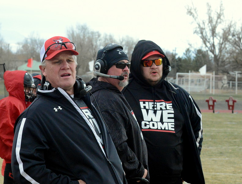 Loveland coaches Wayne McGinn (left), Allan Jeffries and Matt Hoch watch the defense perform during Saturday's 4A state semfinal game at Montrose. Loveland won 42-0 to advance to the state championship. (Mike Brohard/Loveland Reporter-Herald)