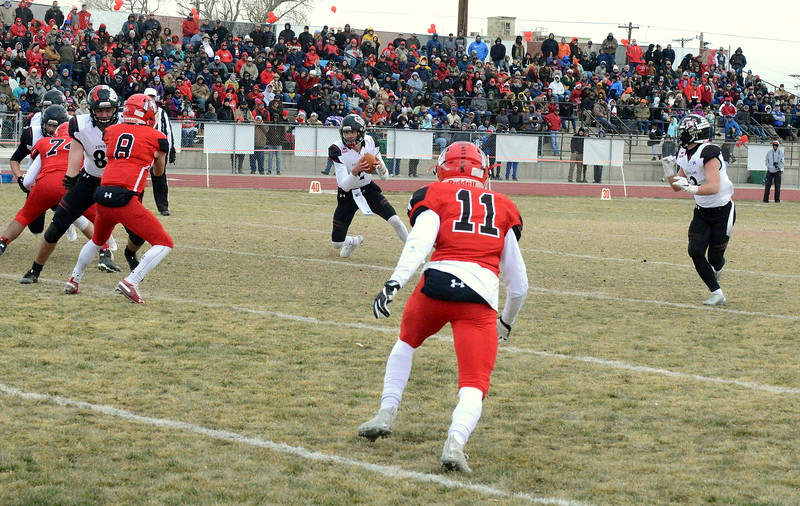 Loveland quarterback Riley Kenny cuts upfield after faking a pitch to Zach Weinmaster duing Saturday's 4A state semifinal game in Montrose. Loveland won 42-0 to advance to the state championship. (Mike Brohard/Loveland Reporter-Herald)