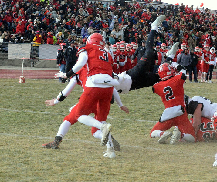 Loveland's Zach Weinmaster gets knocked off his feet as he goes in to score his second touchdown during Saturday's 4A state semfinal game at Montrose. Loveland won 42-0 to advance to the state championship. (Mike Brohard/Loveland Reporter-Herald)