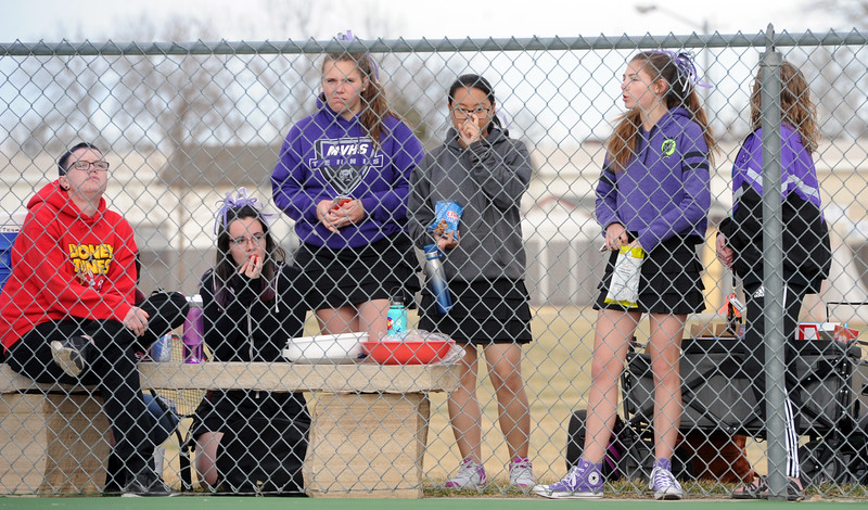 Members of the Mountain View girls tennis team watch during a match on Friday, March 30, 2018 at Loveland High School. (Sean Star/Loveland Reporter-Herald)