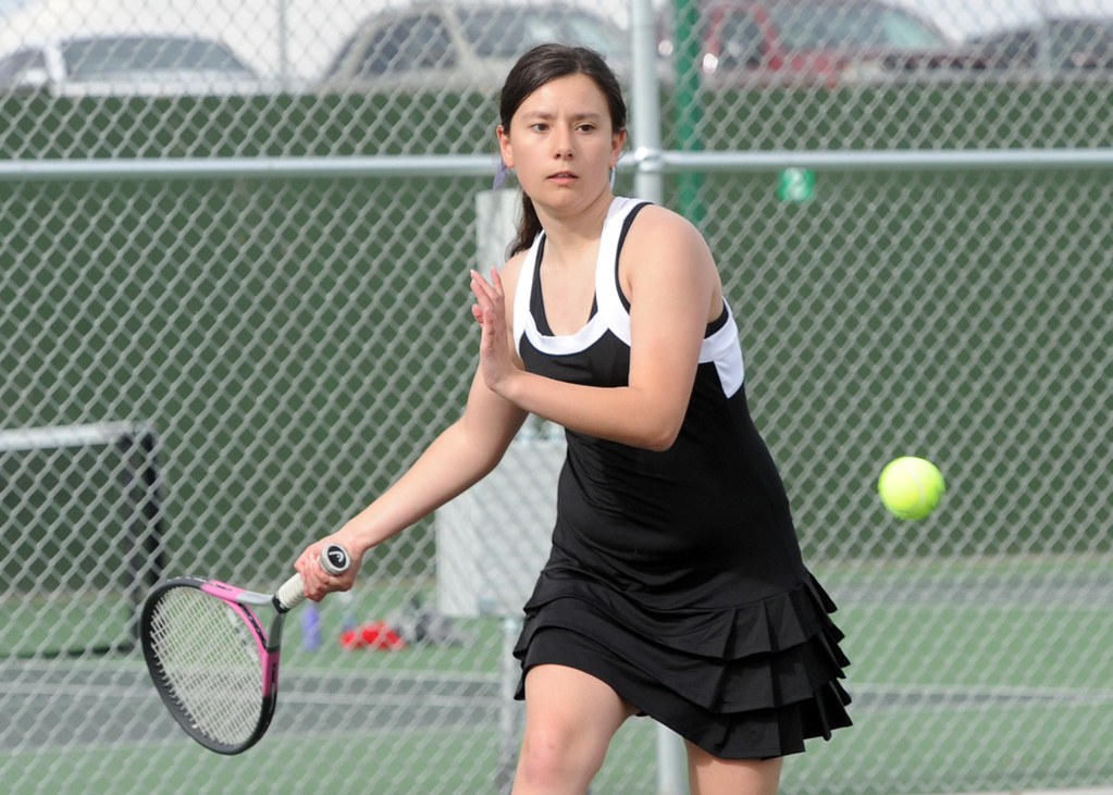 . Mountain View\'s Kali Kelley lines up a forehand during a match on Friday, March 30, 2018 at Loveland High School. (Sean Star/Loveland Reporter-Herald)
