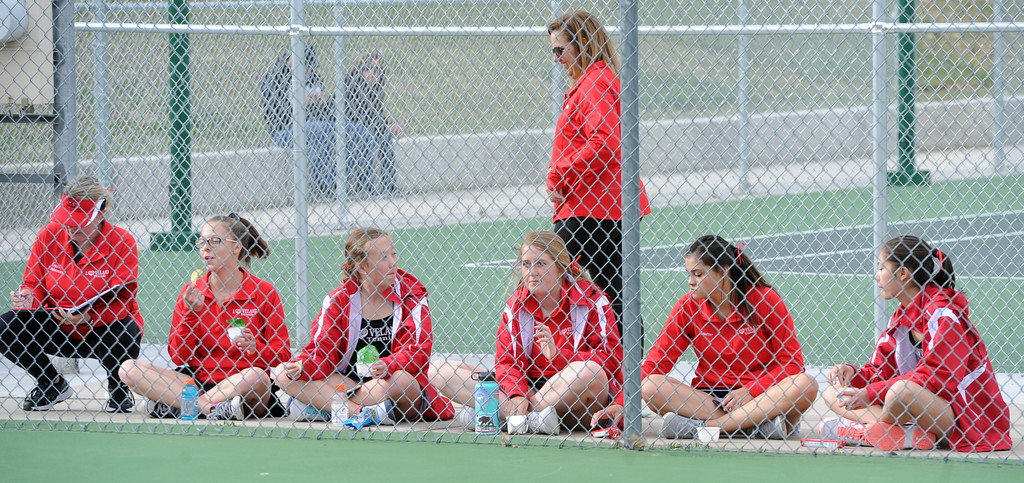 . The Loveland girls tennis team cheers on a teamate during a match on Friday, March 30, 2018 at Loveland High School. (Sean Star/Loveland Reporter-Herald)