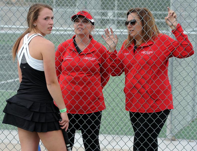 Loveland's Kira Badberg talks with a pair of coaches during a match on Friday, March 30, 2018 at Loveland High School. (Sean Star/Loveland Reporter-Herald)