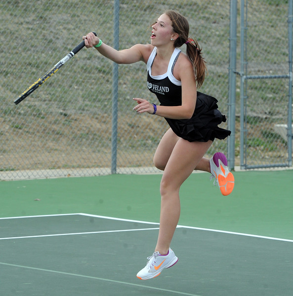 Loveland's Kira Badberg returns a shot during her No. 1 singles match against Mountain View's Megan Heesemann on Friday, March 30, 2018 at Loveland High School. (Sean Star/Loveland Reporter-Herald)