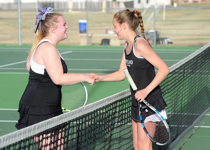 Mountain View's Audra Axline, left, shakes hands with Loveland's Alix Huhta after their No. 3 singles match on Friday, March 30, 2018 at Loveland High School. (Sean Star/Loveland Reporter-Herald)