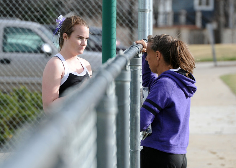 Mountain View's Megan Heesemann talks with coach Patti Lang during a match on Friday, March 30, 2018 at Loveland High School. (Sean Star/Loveland Reporter-Herald)