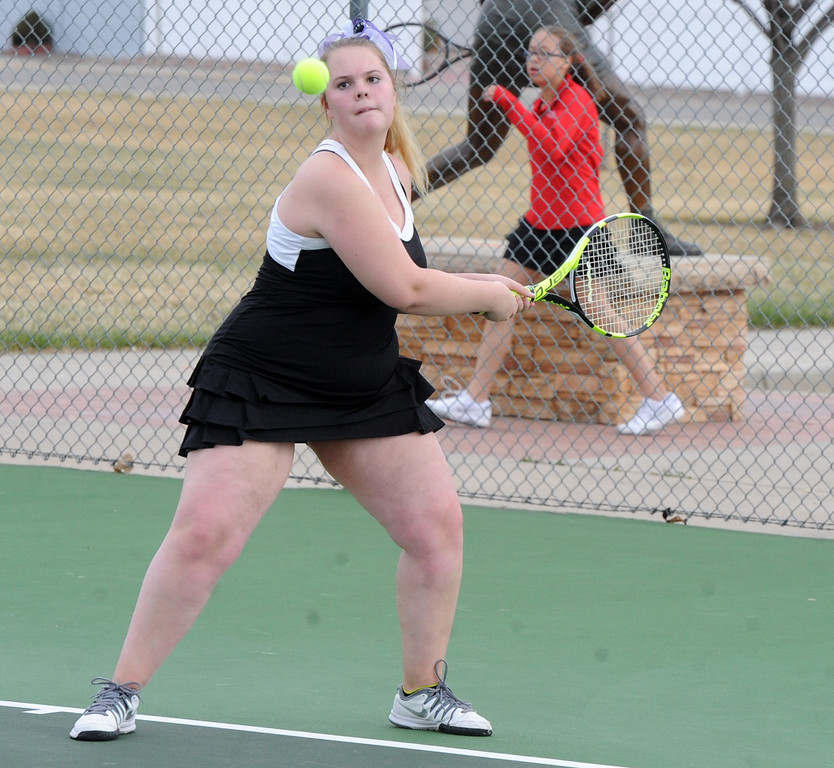 . Mountain View\'s Audra Axline gets ready for a backhand during a match on Friday, March 30, 2018 at Loveland High School. (Sean Star/Loveland Reporter-Herald)