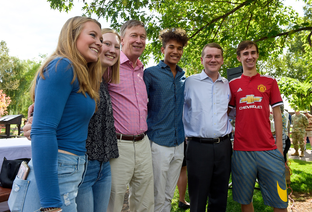 . LYONS, CO - SEPTEMBER 10, 2018: From left: Lyons High School seniors Lily Stewart and Kylen Christiansen, pose for photos with Colorado governor John Hickenlooper, fellow senior Colton Jonjak Plahn, U.S. Sen. Michael Bennet and fellow senior Jaiden Batts before the start of the five year flood commemoration in Bohn Park Sept. 10. The event also included a tree planting and dedication with Governor Hickenlooper and the Gerry Boland family. (Photo by Lewis Geyer/Staff Photographer)