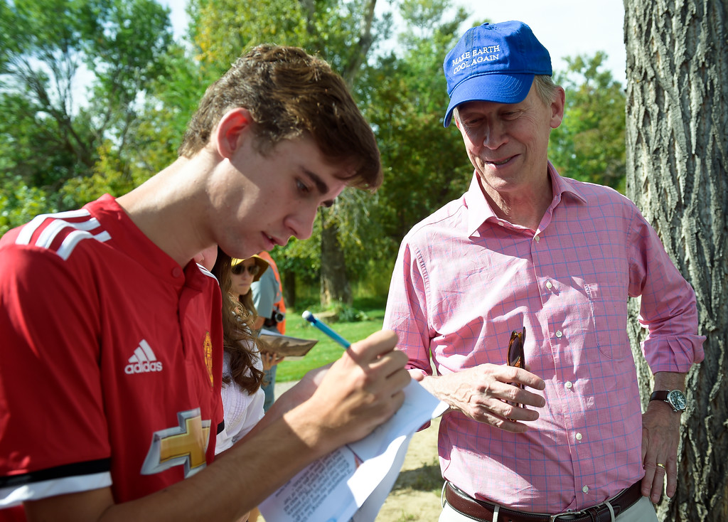 . LYONS, CO - SEPTEMBER 10, 2018: Lyons High School senior Jaiden Batts gives his email address to Colorado governor John Hickenlooper after the five year flood commemoration in Bohn Park Sept. 10. The event also included a tree planting and dedication with Governor Hickenlooper and the Gerry Boland family. (Photo by Lewis Geyer/Staff Photographer)