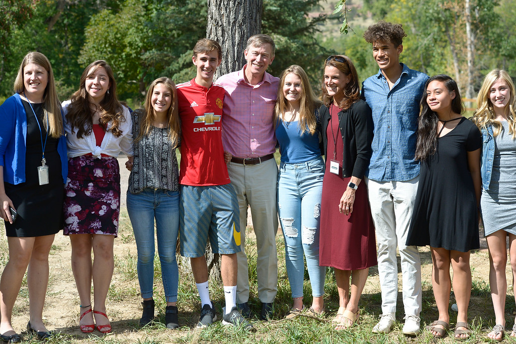. LYONS, CO - SEPTEMBER 10, 2018: Colorado governor John Hickenlooper and mayor Connie Sullivan pose for photos with students and staff from Lyons High School at the five year flood commemoration in Bohn Park Sept. 10. The event also included a tree planting and dedication with Governor Hickenlooper and the Gerry Boland family. (Photo by Lewis Geyer/Staff Photographer)