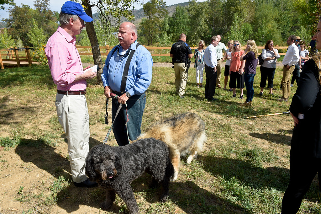 ". LYONS, CO - SEPTEMBER 10, 2018: Colorado governor John Hickenlooper speaks with George ""Skip\"" Durazzo after the five year flood commemoration in Bohn Park Sept. 10. The event also included a tree planting and dedication with Governor Hickenlooper and the Gerry Boland family. (Photo by Lewis Geyer/Staff Photographer)"