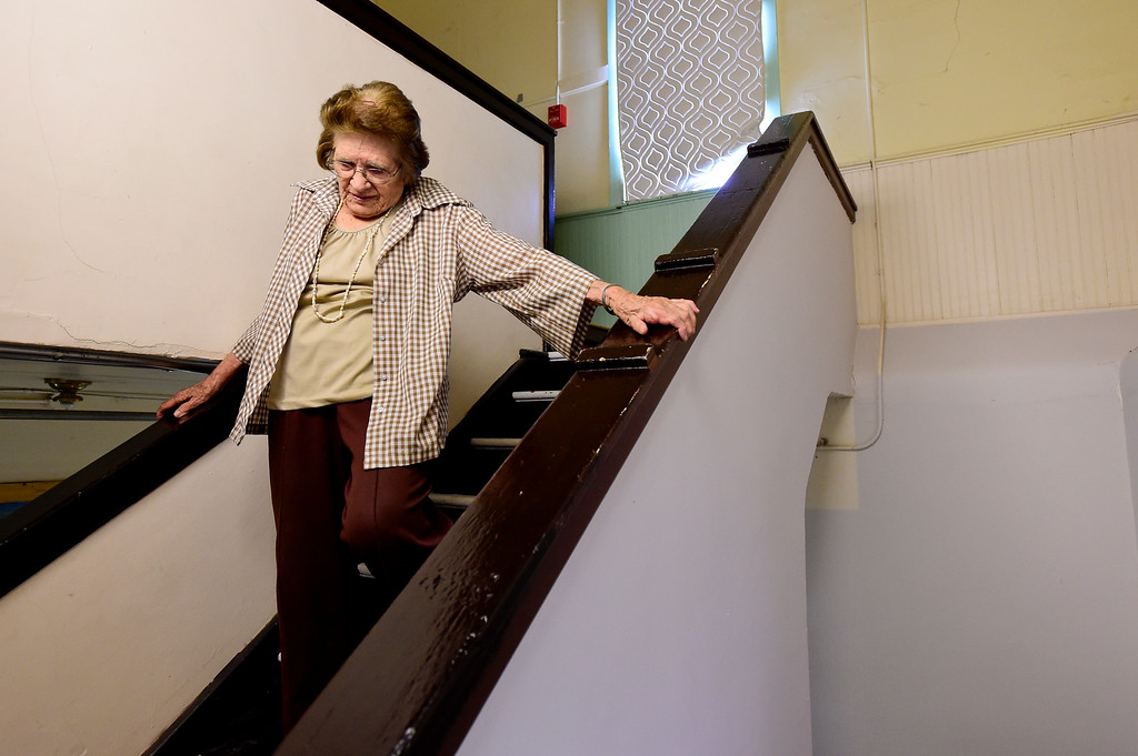 . LaVern Johnson, 89, makes her way down the stairs from the second floor on Thursday at Lyons Redstone Museum. Johnson turns 90 years old on July 23.  Matthew Jonas/Staff Photographer July 13,  2017