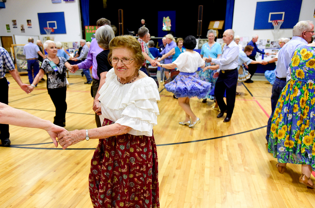 . LaVern Johnson, 89, square dances with the Red Rock Ramblers on Saturday at Lyons Elementary School gymnasium. LaVern attributes part of her long life to square-dancing. Johnson turns 90 years old on July 23.  Matthew Jonas/Staff Photographer July 15,  2017