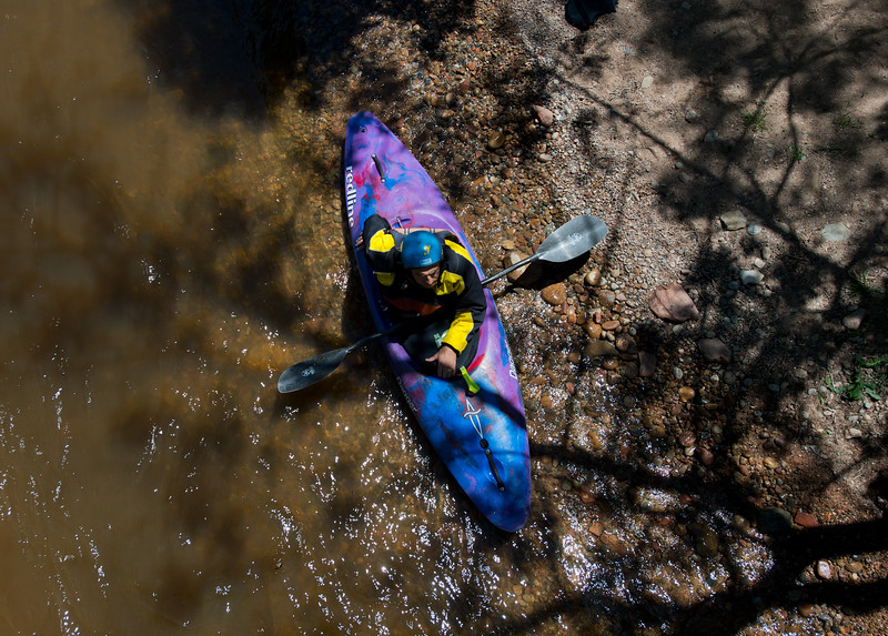 """Nick Sutcliffe sits nearby in case any kayakers need to be rescued during the kayak slalom as part of the Lyons Outdoor Games at Black Bear Hole in Bohn Park on Saturday. <br /> More photos:  <a href=""""http://www.dailycamera.com"""">http://www.dailycamera.com</a><br /> (Autumn Parry/Staff Photographer)<br /> June 4, 2016"""