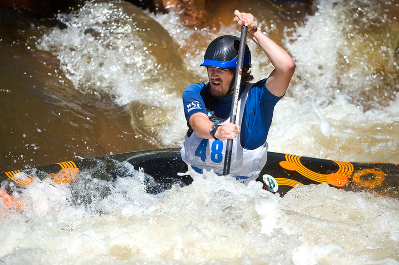 "Ethan Putnam navigates rapids while competing in kayak slalom as part of the Lyons Outdoor Games at Black Bear Hole in Bohn Park on Saturday. <br /> More photos:  <a href=""http://www.dailycamera.com"">http://www.dailycamera.com</a><br /> (Autumn Parry/Staff Photographer)<br /> June 4, 2016"