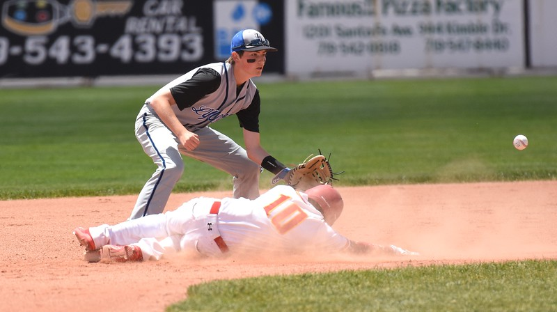 Lyons second baseman Joe McCain fields a throw down to second from catcher Leif Klopsen while trying to catch Rocky Ford's Brandon Cardenas stealing during the Lions' Class 2A state semifinal game against Rocky Ford on Saturday at Runyon Field Sports Complex in Pueblo.