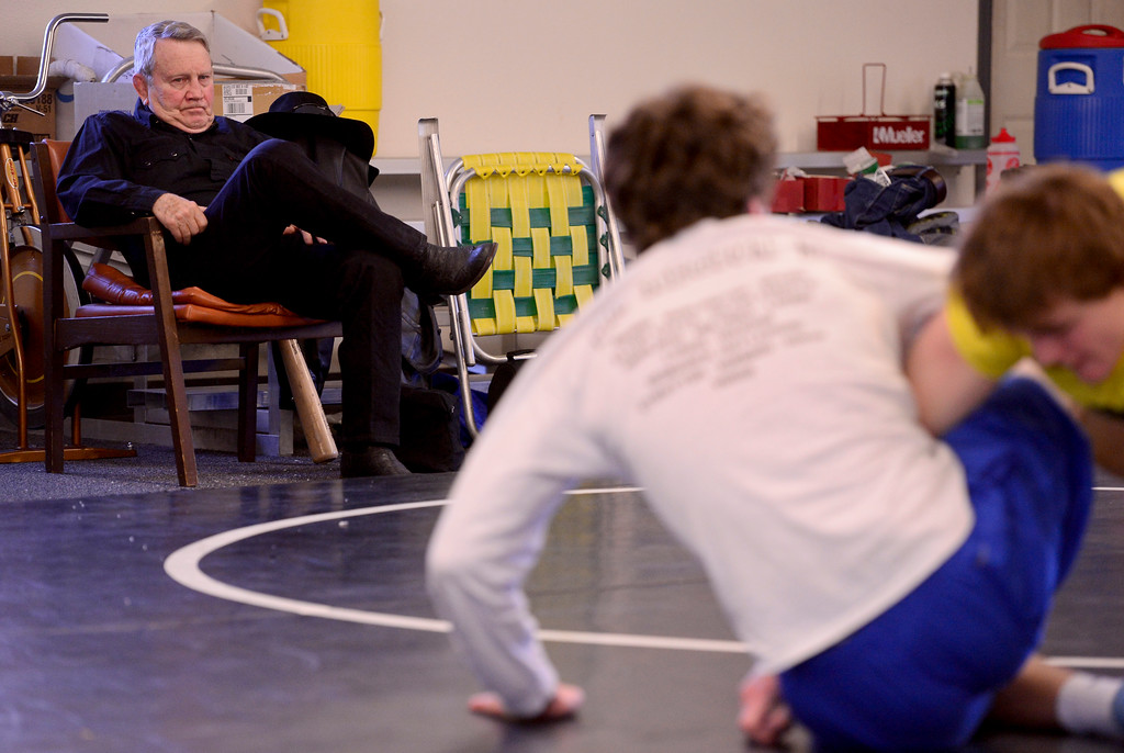 . Lyons coach Linn Long watches wrestlers Karson Bean and Keegan Bean during practice on Wednesday. More photos: BoCoPreps.com. Matthew Jonas/Staff Photographer Feb. 15, 2017