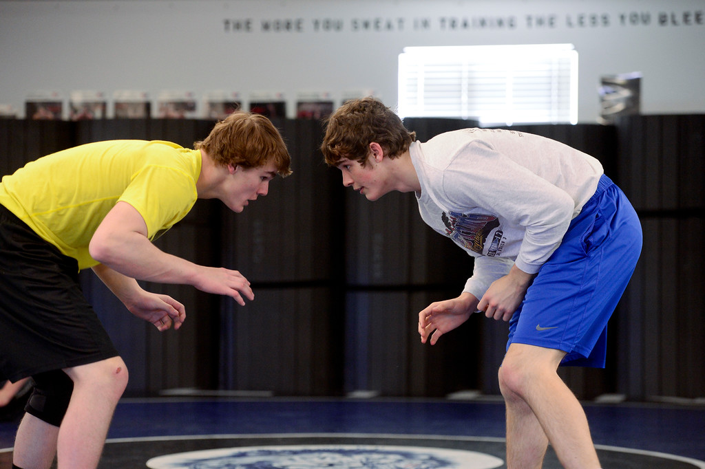 . From left: Lyons wrestlers Karson Bean and Keegan Bean are seen during practice on Wednesday. More photos: BoCoPreps.com. Matthew Jonas/Staff Photographer Feb. 15, 2017