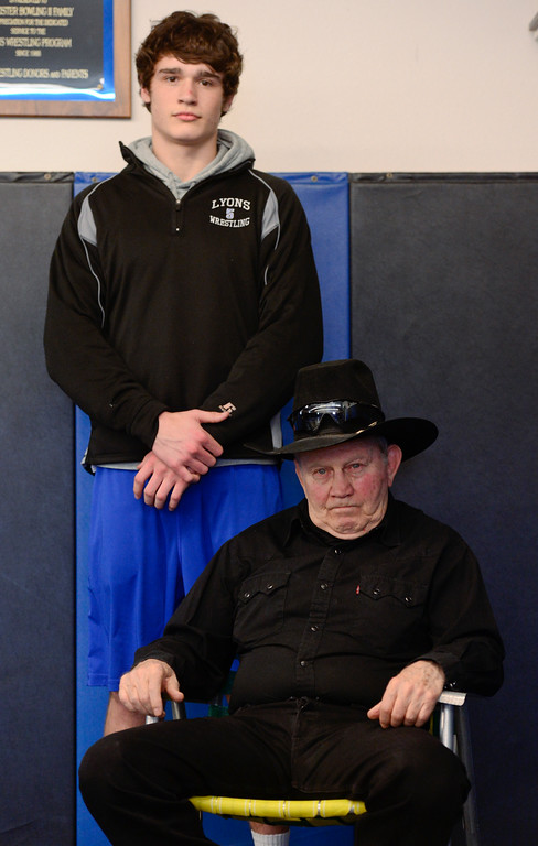 . Lyons coach Linn Long and wrestler Keegan Bean pose for a portrait before practice on Wednesday. More photos: BoCoPreps.com. Matthew Jonas/Staff Photographer Feb. 15, 2017