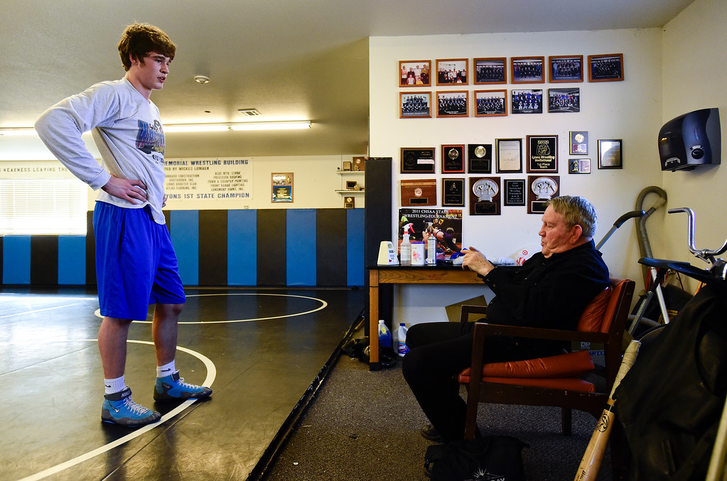 . Lyons wrestler Keegan Bean talks to coach Linn Long during practice on Wednesday. More photos: BoCoPreps.com. Matthew Jonas/Staff Photographer Feb. 15, 2017