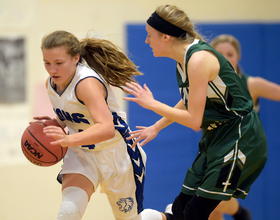 . LYONS, CO - JANUARY 10: Lion Avery Joy brings the ball down court against Eagle Catherine Lacey in the second quarter January 10, 2019 at Lyons Middle/Senior High School. To view more photos visit bocopreps.com. (Photo by Lewis Geyer/Staff Photographer)