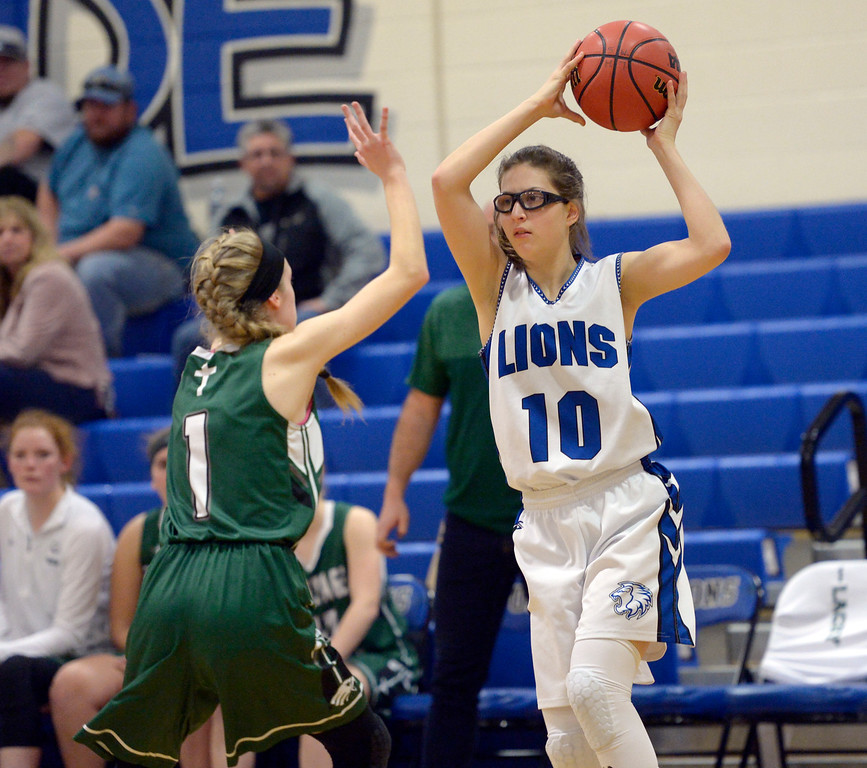 . LYONS, CO - JANUARY 10: Lion Hope Kincaid looks to pass away from Eagle Catherine Lacey in first the quarter January 10, 2019 at Lyons Middle/Senior High School. To view more photos visit bocopreps.com. (Photo by Lewis Geyer/Staff Photographer)